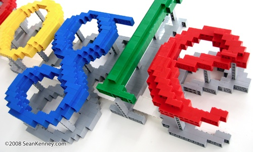 Wall-mounted sculpture of company logo, built with LEGO bricks