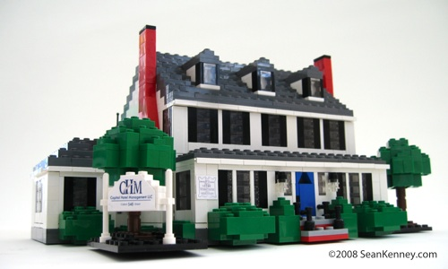 Historic house, LEGO bricks.  By Sean Kenney.  Dormers shingles front step porch windows chimney sign trees colonial