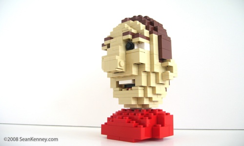 Miniature LEGO bust.  Figurative head sculpture created with LEGO bricks.