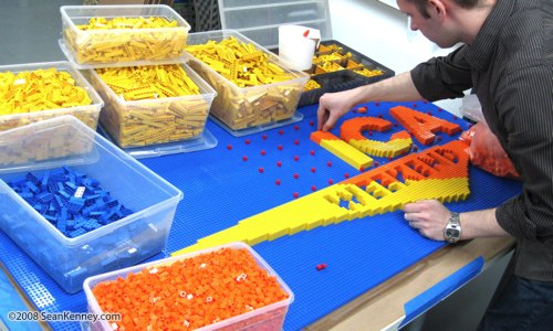 Artist Sean Kenney working on his Good Morning America logo, built with 11,500 LEGO bricks